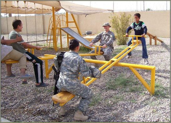 Armed American Troops Force Iraqis to Seesaw Until They Talk!