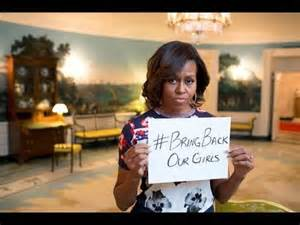 Michelle Obama and sign