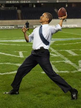 Obama throwin football