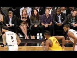royal couple at basketball game