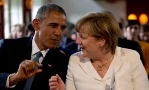 U.S. President Barack Obama and German Chancellor Angela Merkel attend a concert at the hotel castle Elmau in Kruen, Germany, June 7, 2015. Leaders from the Group of Seven (G7) industrial nations met on Sunday in the Bavarian Alps for a summit overshadowed by Greece's debt crisis and ongoing violence in Ukraine. (REUTERS/Virginia Mayo)