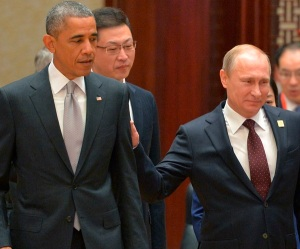 Russian President Vladimir Putin, right, passes by US President Barack Obama at the Asia-Pacific Economic Cooperation (APEC) Summit, Tuesday, Nov. 11, 2014 in Beijing. (AP Photo/RIA Novosti, Presidential Press Service)