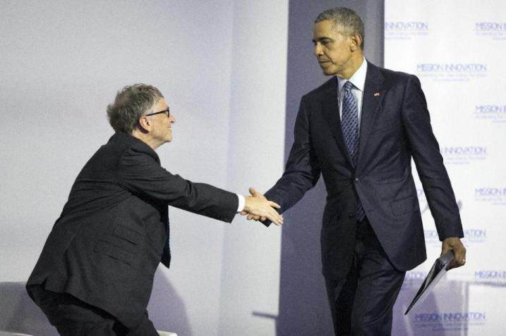 President Barack Obama, right, shakes hands with Bill Gates after delivering remarks during a Mission Innovation event at COP21, United Nations Climate Change Conference, in Le Bourget, outside Paris, on Monday, Nov. 30, 2015. (AP Photo/Evan Vucci)