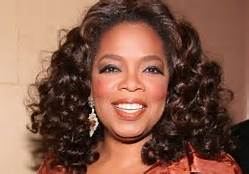 Oprah... Wearing white women curls. Shame
